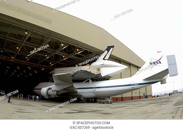 02/24/2001 --- Photo courtesy of Boeing photographer Bob Williams. The orbiter Columbia, atop a modified Boeing 747, rolls under protective cover at Palmdale