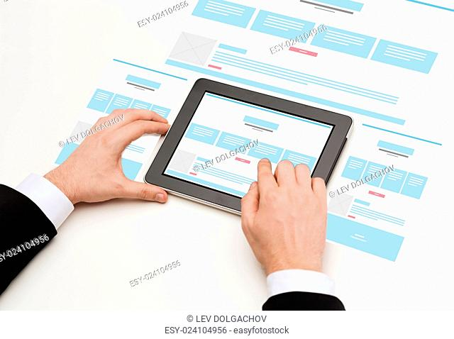 business, internet, web design and technology concept - close up of man hands touching tablet pc computer with web page design on screen