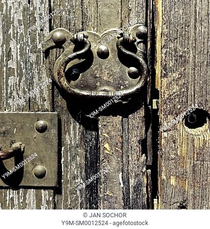 An antique door knocker is seen hung on the rotten wooden door of a Spanish colonial house in Morelia, Mexico, 2 November 2014