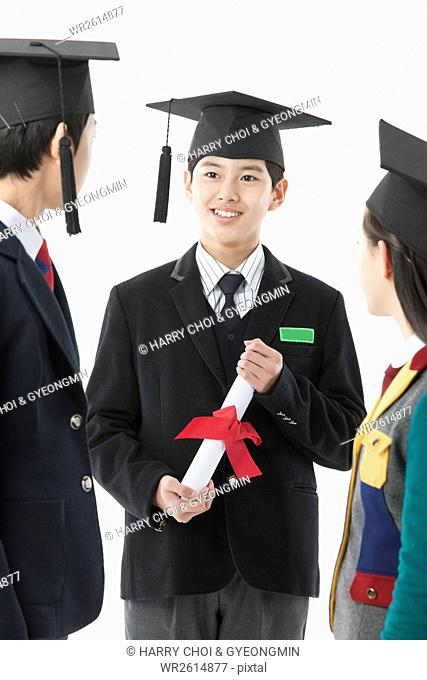 Smiling boy graduate with his friends
