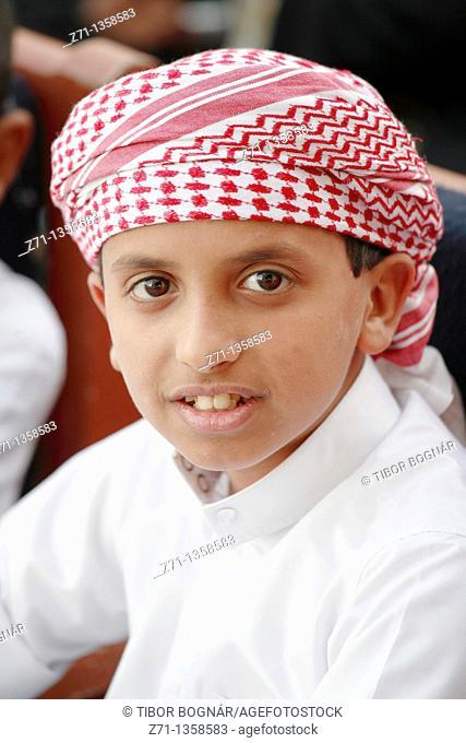 Qatar, Doha, Souq Waqif, boy portrait