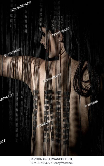 Erotica nude woman back through a curtain wire