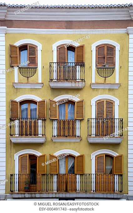 Facade of building with nine large windows