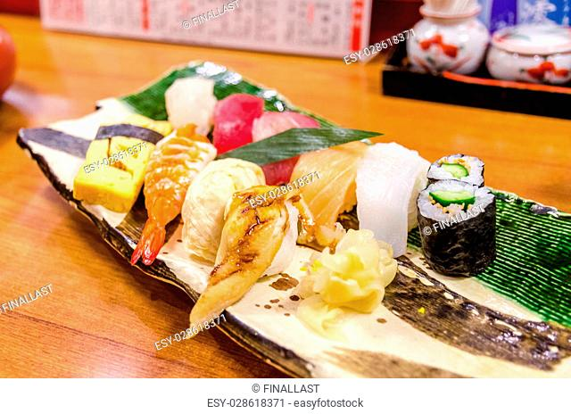 Sushi, Fresh traditional Japanese seafood set served on plate