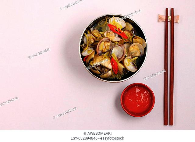 herbal clam soup Vietnam style served on a white background