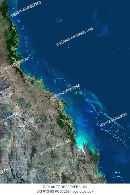 Satellite view of the Central Great Barrier Reef along Queensland's coastline in north-east Australia. The area covered goes from Cairns at north down to...