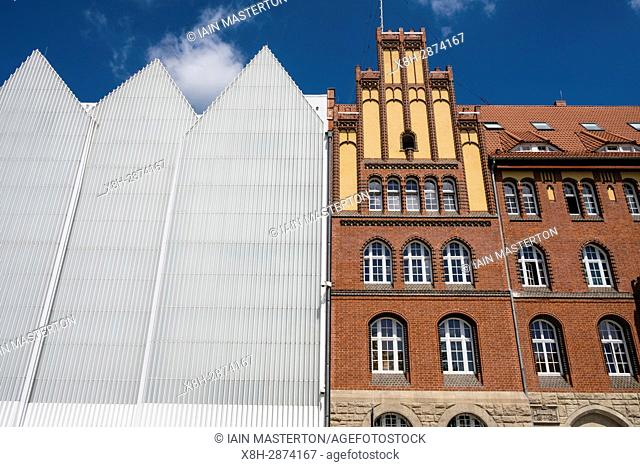 Exterior view of Szczecin Filharmonia concert hall contrasting with traditional architecture of adjacent building in Szczecin , Poland