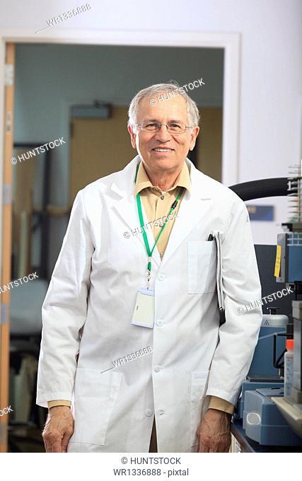Engineering professor in chemical analysis laboratory