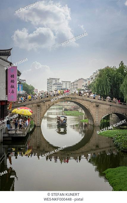 China, Shanghai, Bridge with tourists in Qibao Ancient Town