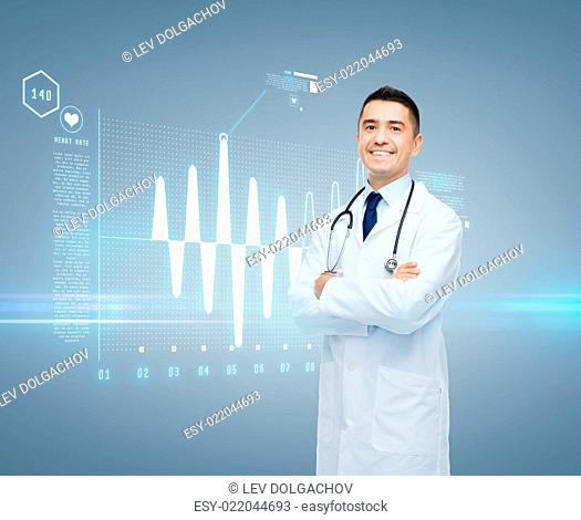 healthcare, cardiology, future technology and people and medicine concept - smiling male doctor in white coat with cardiogram on virtual screen over gray...