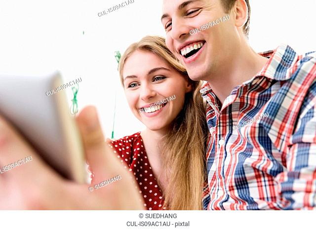 Couple on video chat using digital tablet