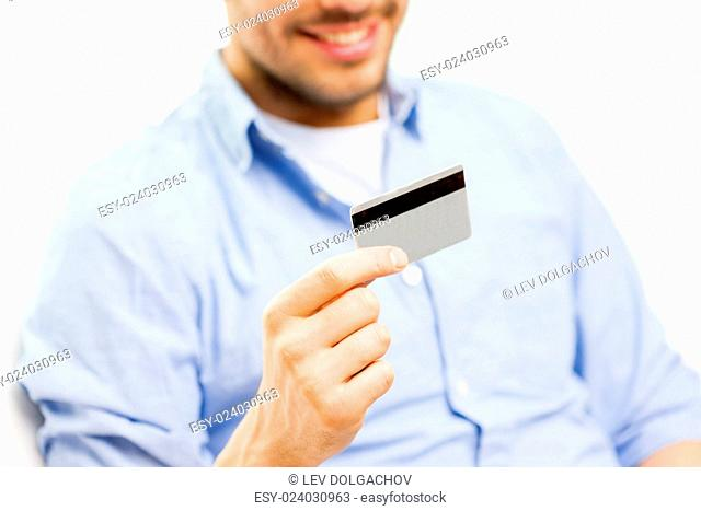 technology, people and online shopping concept - close up of man with credit card