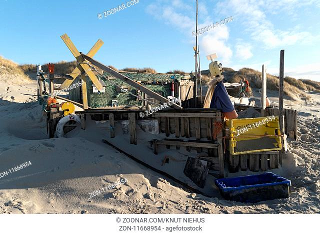 AMRUM, GERMANY - JANUARY 02, 2018: On the Kniepsand Beach of the North Frisian Island Amrum in Germany Land-Artists made Beach Huts and other Objects out of...