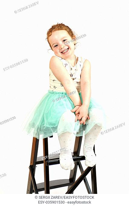 Fashion little girl in green dress, in catwalk model pose, stock photo. Image 09