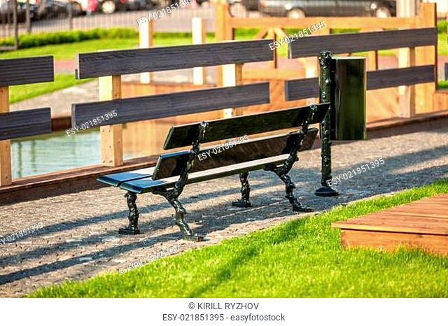 photo of bench at park near river
