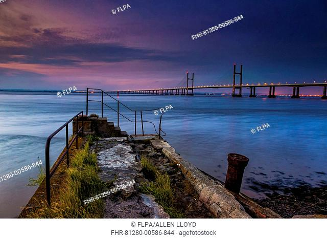 View of jetty and road bridge at sunrise, Sudbrook Jetty, Second Severn Crossing, River Severn, Severn Estuary, Monmouthshire, Wales, July