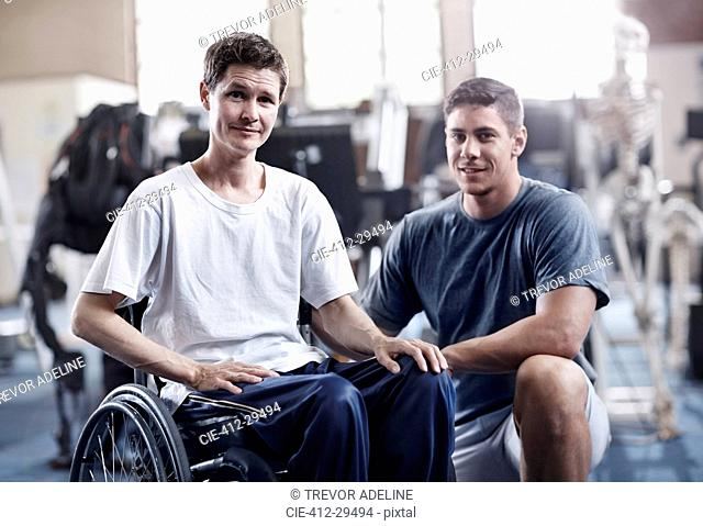Portrait confident physical therapist and man in wheelchair