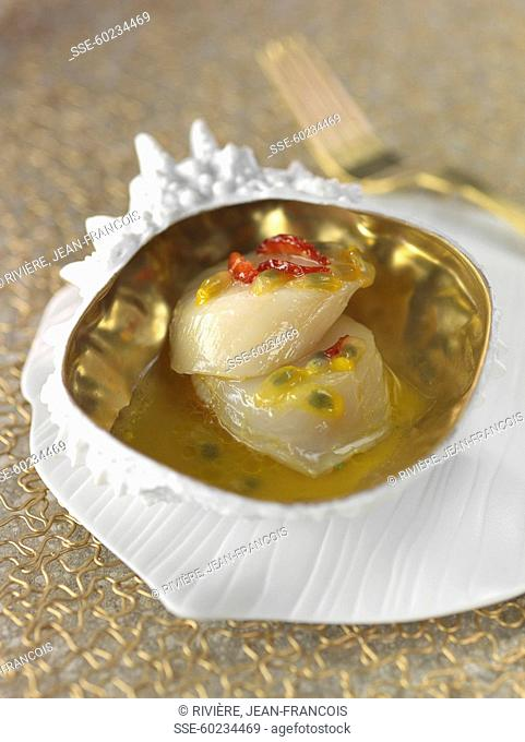 Raw scallops in Champagne,passionfruit and pepper sauce