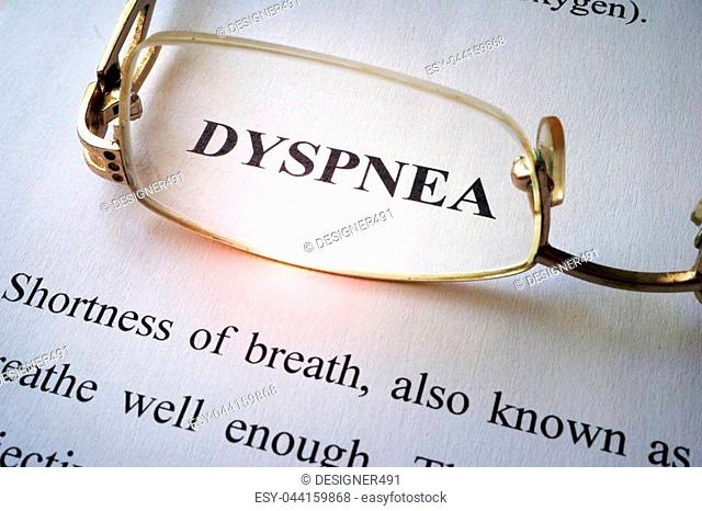 Paper with word dyspnea and glasses
