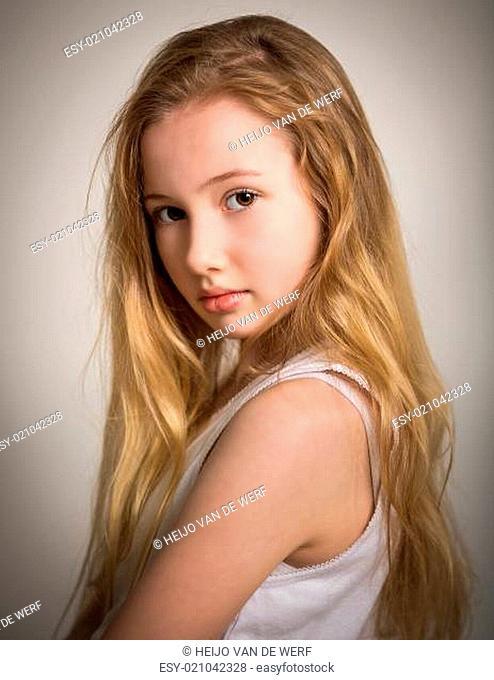 Beautiful young shy blond girl