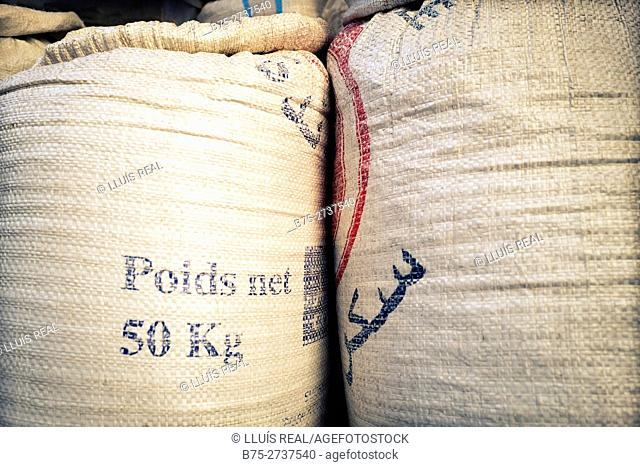 Close up of two bags with texts in French and Arabic (Poids Net 50Kg). Chaouen, Tangier-Tetouan, Morocco