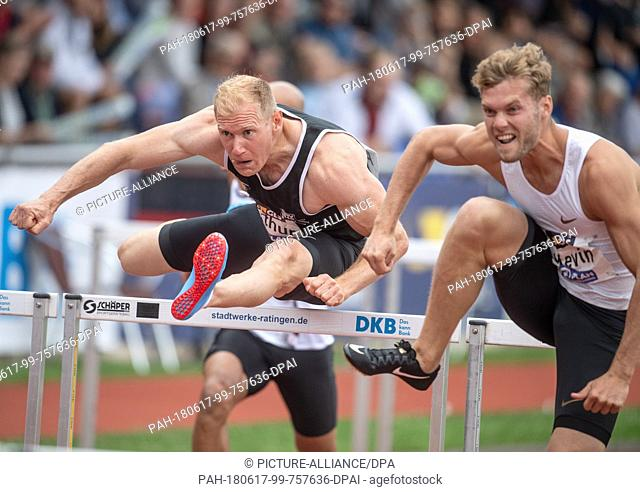 17 June 2018, Germany, Ratingen: Athletics: Mehrkampf-Meeting. Decathlon athletes Arthur Abele (L) of Germany and Kevin Mayer of France in action during the 110...