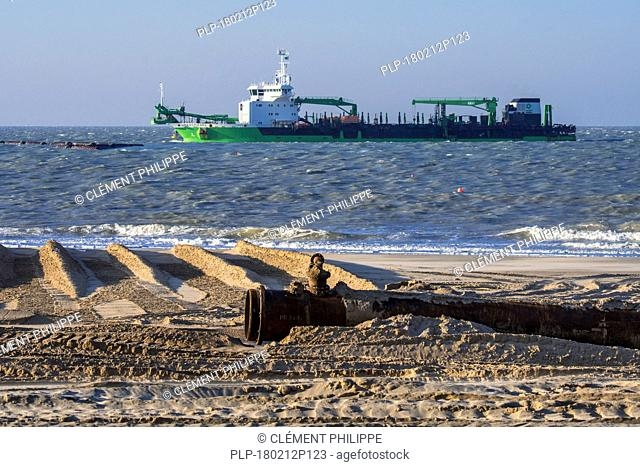 DEME trailing suction hopper dredger Uilenspiegel at sea, used for sand replenishment / beach nourishment to make wider beaches to reduce storm damage