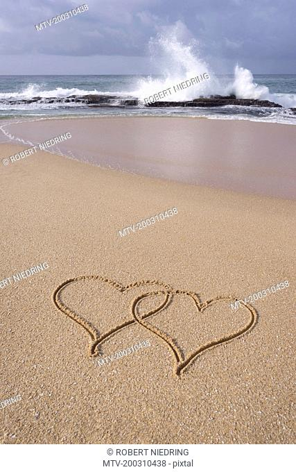 High angle view of hearts shape drawn in sand on beach, Western Province, Sri Lanka