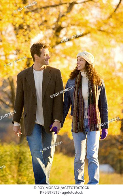 Couple walking on country road in the fall