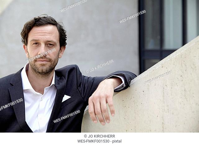 Portrait of sceptical looking businessman in a modern building