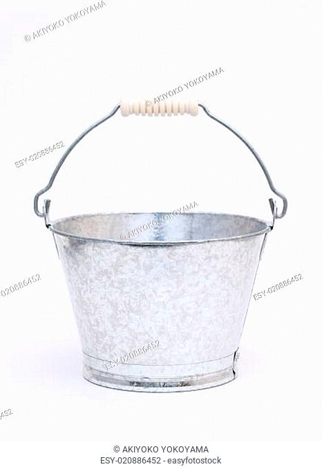 Empty metal bucket on gray background