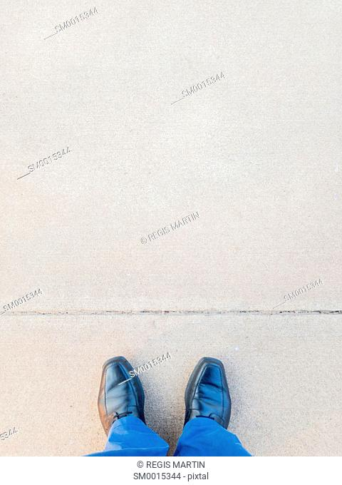 Personal perspective from a man standing in front of a line traced on the ground