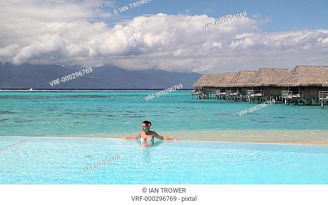 Woman in pool at Sofitel Hotel, Moorea, Society Islands, French Polynesia