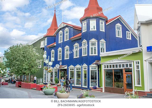 Iceland Akureyri downtown center second largest city walking street Hafnarstraeti Street with blue cafe building