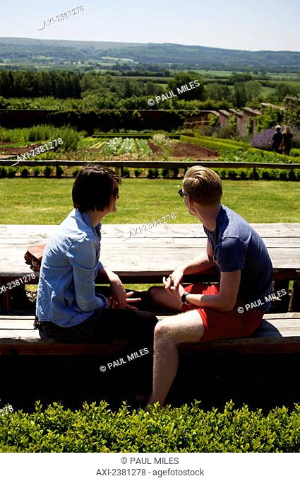 A couple sits enjoying the view of Barley Wood Walled Garden; Wrington, England