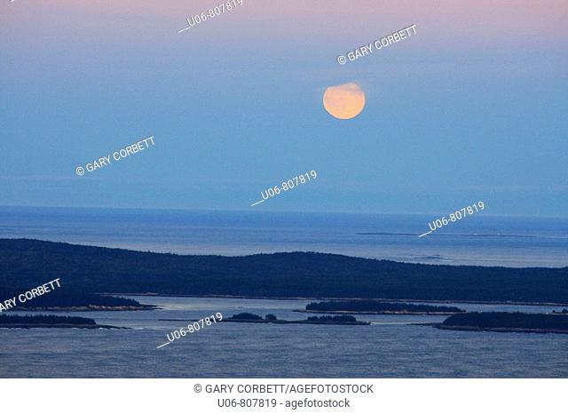 a full moon over bar harbor maine usa