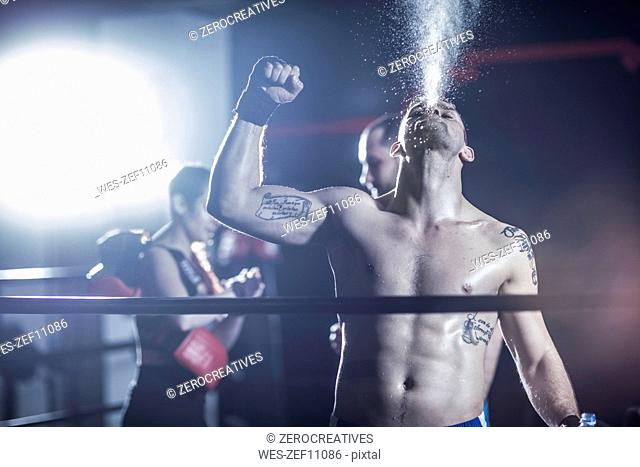 Boxer celebrating after win in boxing ring