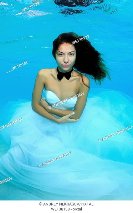 Young beautiful woman in a wedding dress under water, Indian Ocean, Maldives