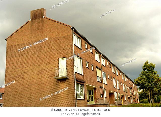 Block of rowhouses with thunderstorm approaching. Shot in Limburg province of the Netherlands
