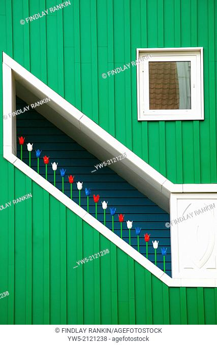 Wooden stairway in Amsterdam decorated with wooden tulips painted in red, white and blue