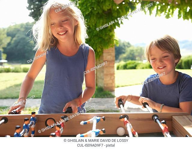 Children playing foosball