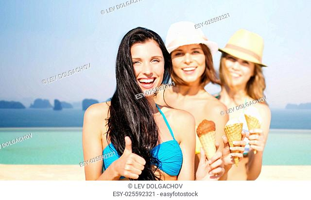 summer holidays, vacation, travel and people concept - group of smiling young women with ice cream showing thumbs up over infinity edge pool background