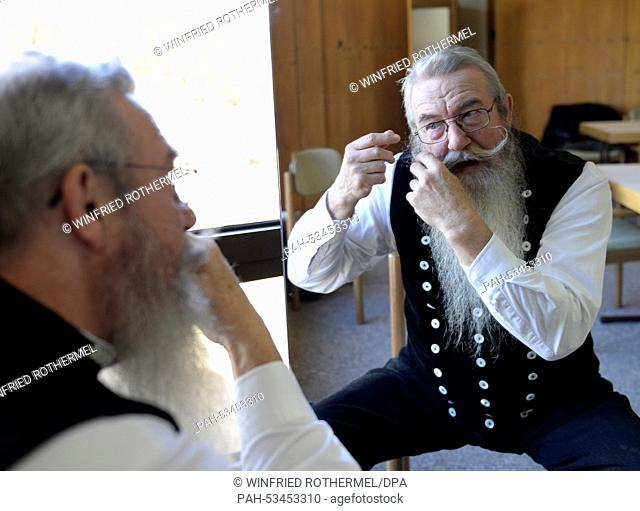 Wilfried Jezierrny styling his beard before his appearance in the European Beard Championship in Schluchsee, Germany, 08 November 2014