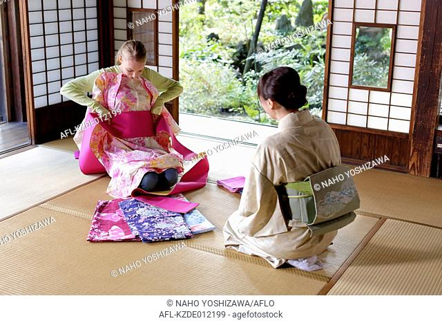 Caucasian woman wearing yukata at traditional Japanese house
