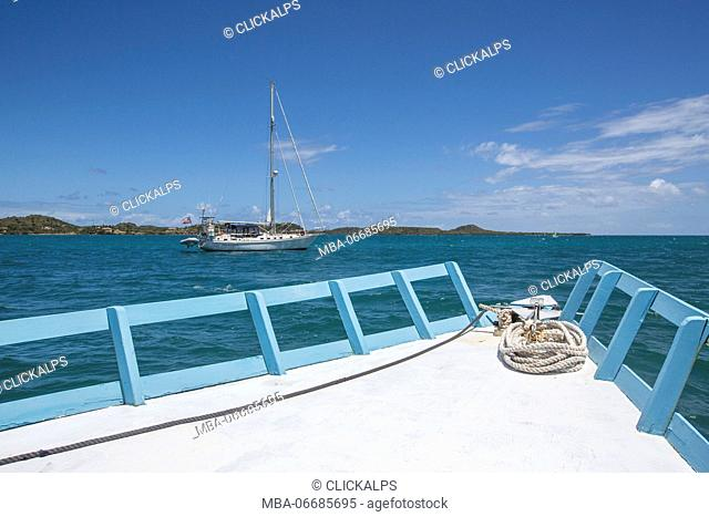 Sailboats and vessels in the turquoise waters of the Caribbean Sea Green Island Antigua and Barbuda Leeward Island West Indies