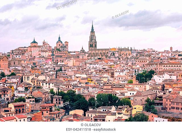 Old city of Toledo with Primate Cathedral of Saint Mary, churches of San Ildelfonso, San Roman and Santo Tome at sunset, Castilla La Mancha, Spain