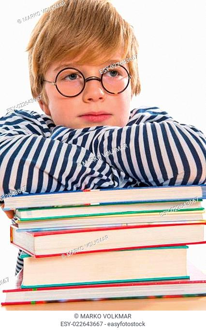 boy with books is reflecting