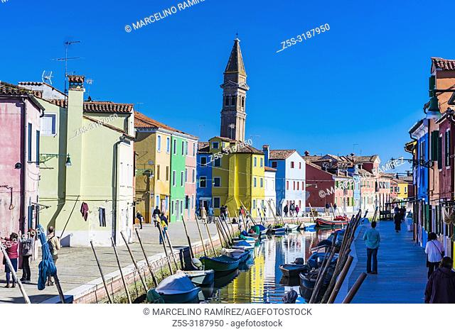 The leaning belfry seen from the canal. Burano, Venice, Veneto, Italy, Europe