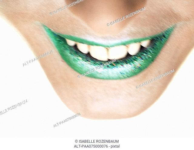 Woman wearing green lipstick, close up of smiling mouth, high angle view