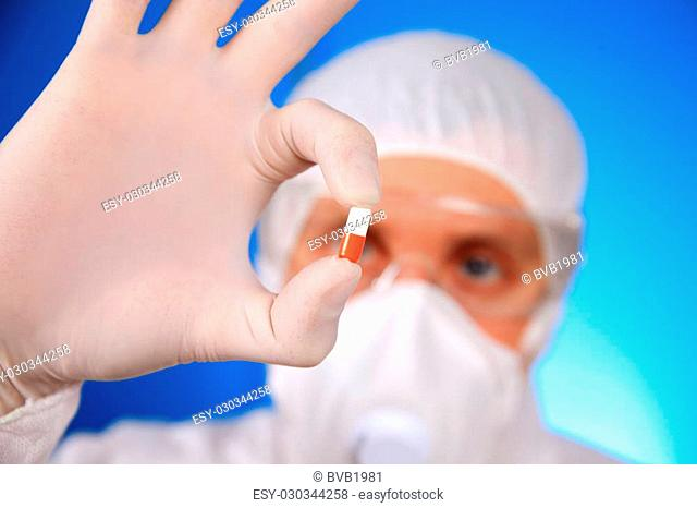 Close-up of a medical scientist researching a pill in the laboratory